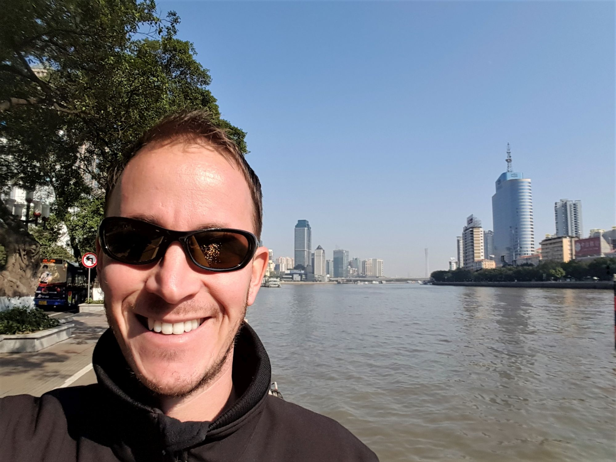 Top things to do China Guangzhou skyline river happy face traveller